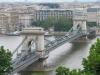 Спроектировал цепной мост известный в то время английский инженер Уильям Кларк, поэтому он очень интересным образом похож на одно из сооружений, что соединяет два берега Темзы. Открыли цепной мост в 1849 году и еще несколько лет после этого события его считали настоящим инженерным чудом мира, ведь его длина и высота были уникальными для того времени.