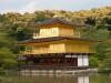 Вначале здесь была резиденция военных правителей,  и потом ее переделали в храм. Кинкакудзи и его чудеснейший сад появился в 1397 году. Это трёхэтажное здание по всему периметру окружено верандами, а крыша устлана тонкими пластинами из золота.